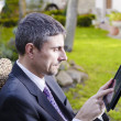 Business Man Outdoor Desperate with his Notebook - Stock Photo