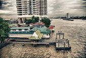 Buildings over Chao Phraya in Bangkok — Stock Photo