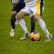 Protecting the Ball during a Football Match — Photo