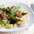 Pasta with asparagus and dried tomato — Stock Photo #6105147