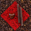 Stock Photo: Sweets on the roasted coffee beans