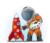 Astronaut painting the rocket — Stock Vector