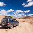 Offroad car in the desert — Stock Photo