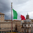 Stock Photo: Flag of Italy against gray sky. architecture