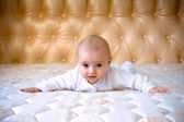 Little baby on a big bed — Stock Photo
