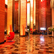 Modern lobby interior in night illumination, Pattaya, Thailand - Stock Photo