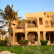 The Arabic style villa and palm during sunset at luxury hotel, D — Stock Photo #5632911
