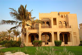 The Arabic style villa and palm during sunset at luxury hotel, D — Stock Photo