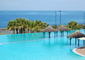 Swimming pool and beach of luxury hotel, Tenerife island, Spain — Stock Photo