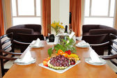 Interior of the luxury villa served with champagne and fruits, T — Stock Photo