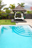 Bali type hut and swimming pool at luxury villa, Tenerife island — Stock Photo