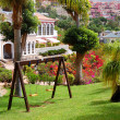 Swing on the green lawn at luxury hotel, Tenerife island, Spain — Stock Photo