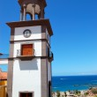Tower with clock at the luxury hotel, Tenerife island, Spain — Stock Photo #6049913