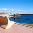Stock Photo: Seafront and bench at Playde las Americas, Tenerife island, Sp