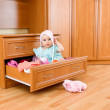 Baby was sitting in the closet. — Stock Photo