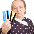 Stock Photo: Mature womwith debit card.