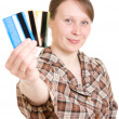Girl with a debit card in hand — Stock Photo
