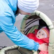 A woman with a baby in a stroller. — Stock Photo #5580521
