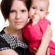 Mother with a baby on a white background — Stock Photo