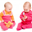 Stock Photo: Two baby on a white background.