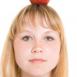 Girl with an apple on a white background. — Stock Photo