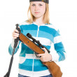 A teenager with a gun on a white background. — Stock Photo