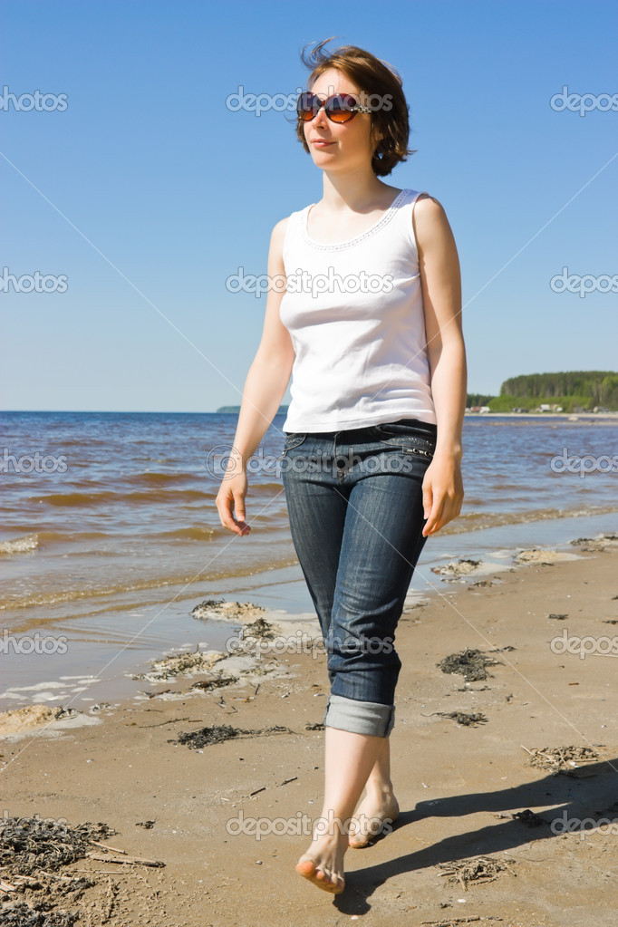 Woman in sunglasses on the beach.  Stock Photo #6104189