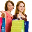 Girls with shopping on white background. — Stok fotoğraf
