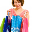 Girl with shopping on white background. — Stock Photo