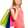 Girl with shopping on white background. — Stock Photo #6204452