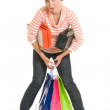 Girl with shopping on white background. — Stock Photo #6204796