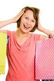 Ragazza con lo shopping su sfondo bianco. — Foto Stock