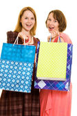Girls with shopping on white background. — Stock Photo