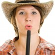 Cowboy woman with a gun on a white background. - Stock Photo