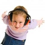 Little girl listening to music on white background — Stock Photo