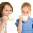 Mom and daughter drink milk. — Stock Photo