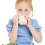 Girl drinking milk on a white background. — Stock Photo