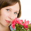 Girl smelling a flower on a white background. — Stock Photo
