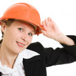 Businesswoman in a helmet on a white background. — Stock Photo