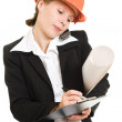 Businesswoman in a helmet on a white background. — Stock Photo #6515869