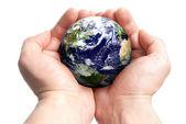 Globe in hands — Stock Photo