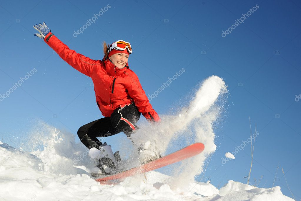 Pretty young woman on snowboard — Stock Photo #5539683