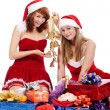 Two pretty women in christmas clothes — Stock Photo