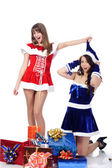 Playful girls in christmas clothing — Stock Photo