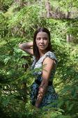 Girl in fir-tree wood — Stock Photo
