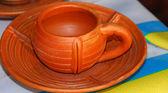 Aarden aardewerk terracotta thee kop en schotel — Stockfoto