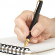 Hand with pen writing on notebook — Stock Photo
