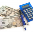 Calculator and dollars on the table — Stock Photo