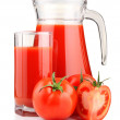 Jug, glass of tomato juice and fruits with green leaves isolated — Stock Photo #5405158