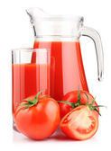 Jug, glass of tomato juice and vegetables isolated — Stock Photo